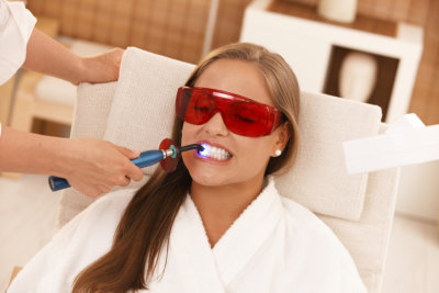 woman having a teeth whitening