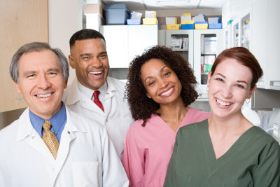 dentist and staffs smiling
